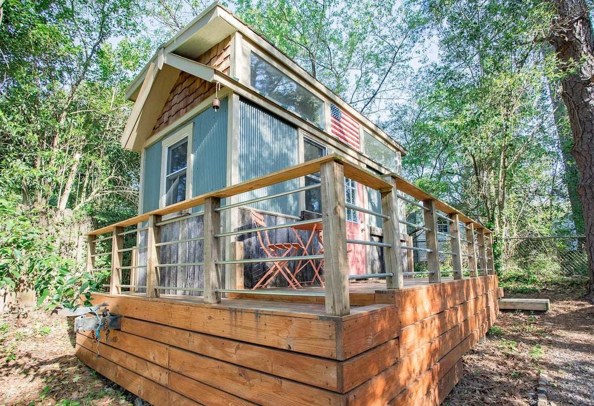 A sleeping loft in this Durham, North Carolina, tiny home provides the feeling of a tree house.  Photo 14 of 24 in Check Out These 23 Tiny Houses Perfect for an Autumn Getaway