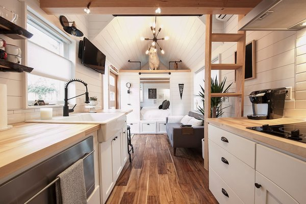 Unique Tiny House in Atlanta, Georgia, offers an area for outdoor dining, a ping pong table and a fire pit.