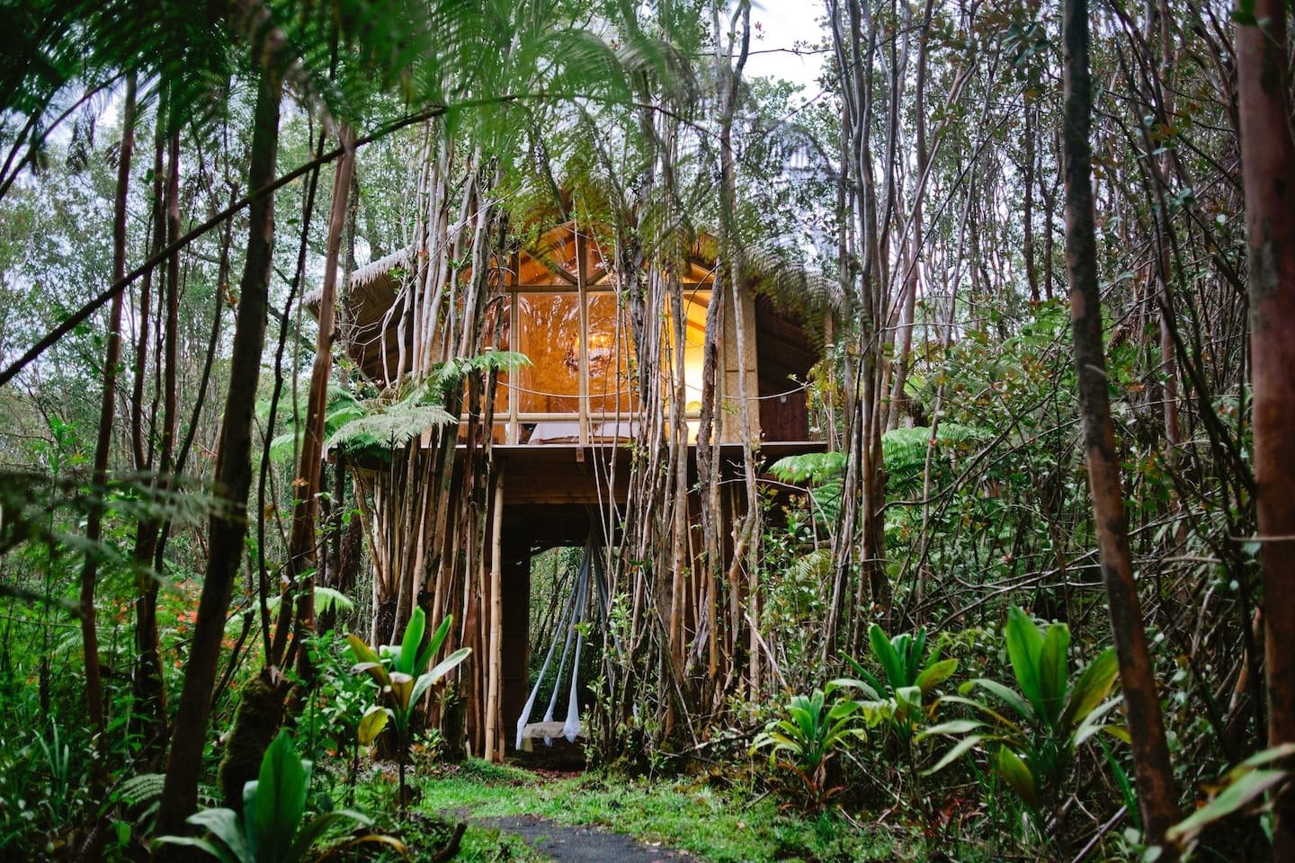 The Dreamy Tropical Tree House in Fern Forest, Hawaii, is located 10 miles from Volcano National Park.  Photo 17 of 24 in Check Out These 23 Tiny Houses Perfect for an Autumn Getaway