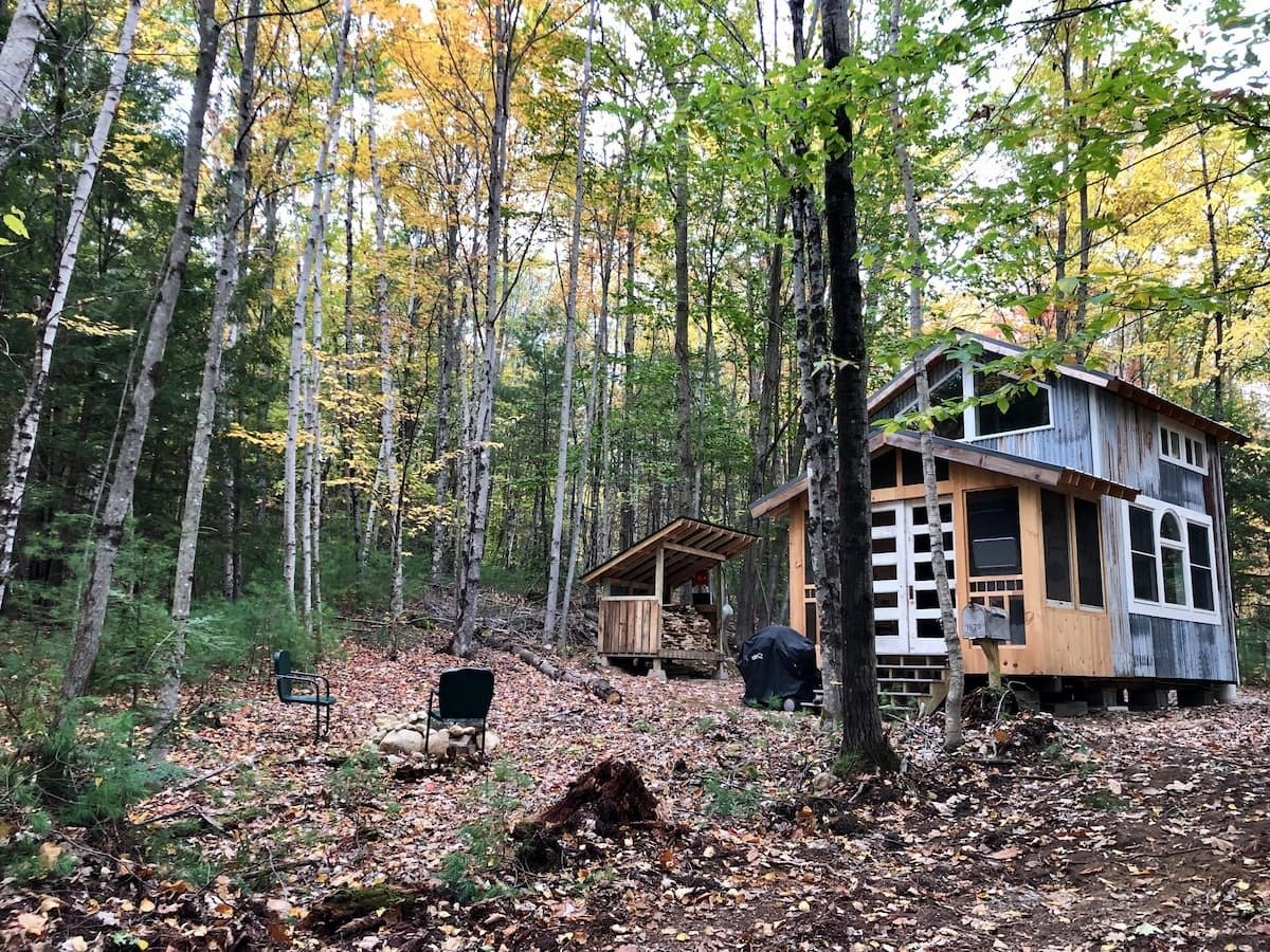 Two Cedar Tiny House in Winthrop, Maine, is sided with corrugated metal and features a covered front porch.  Photo 18 of 24 in Check Out These 23 Tiny Houses Perfect for an Autumn Getaway