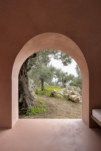 The walls, floor, and ceiling of one of the Olive Houses is enveloped in a pale pink tone—the color found on the leaves of the olive trees that dot the landscape.