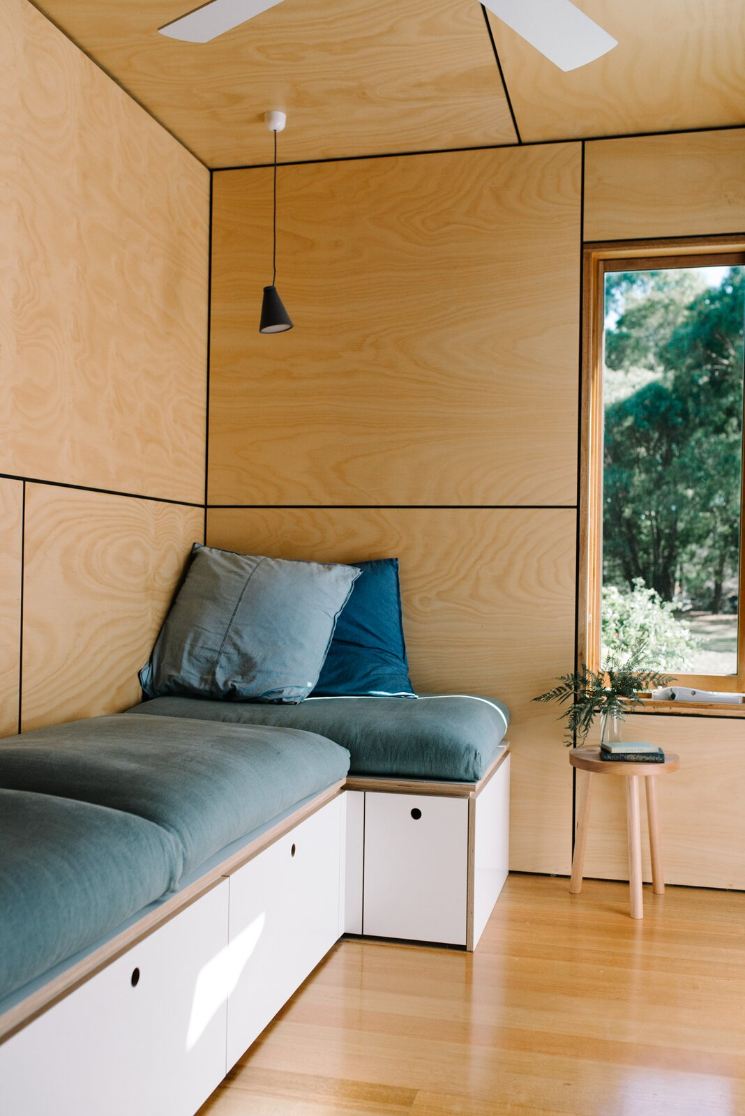 Wattle Bank shipping container tiny home built-in sofa with storage