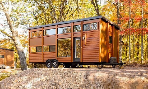 Exterior, Tiny Home Building Type, Flat RoofLine, and Wood Siding Material ESCAPE tiny houses are listed as rental properties through Airbnb or similar platforms.  Photo 4 of 5 in These 5 Companies Want to Build a Tiny House in Your Backyard for Free