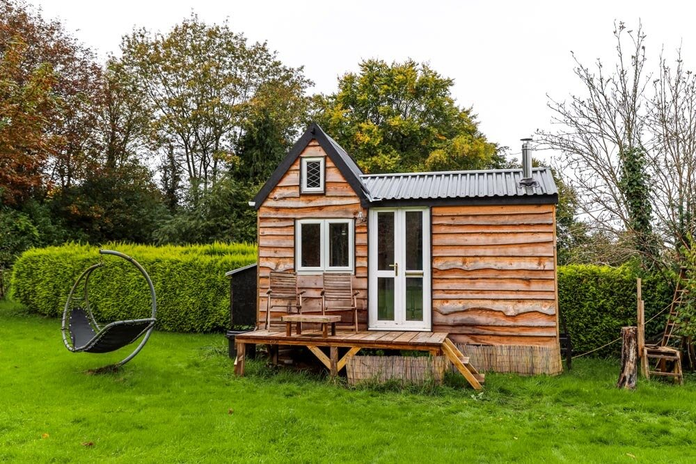 Exterior, Tiny Home Building Type, Metal Roof Material, Gable RoofLine, and Wood Siding Material A tiny home in England, built by a 17-year-old for $8,000, is wrapped in reclaimed wood.  Photo 9 of 12 in 12 Inspiring Tiny Homes That Were Entirely DIY'ed