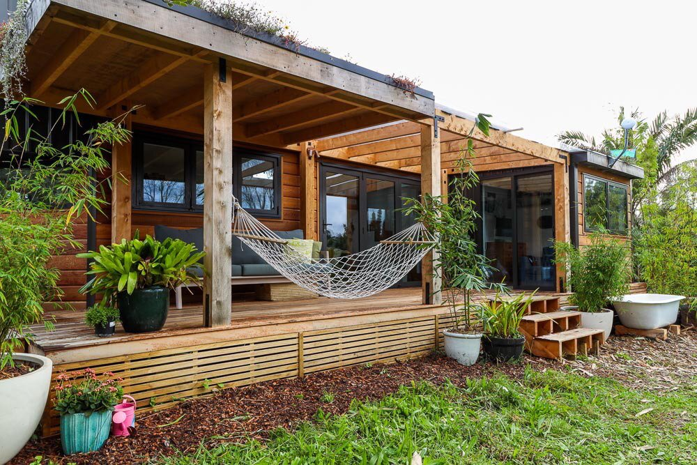 Exterior, Tiny Home Building Type, Wood Siding Material, and Flat RoofLine Shaye's tiny home is clad with metal and wood and features a living wall on the interior.  Photo 11 of 12 in 12 Inspiring Tiny Homes That Were Entirely DIY'ed