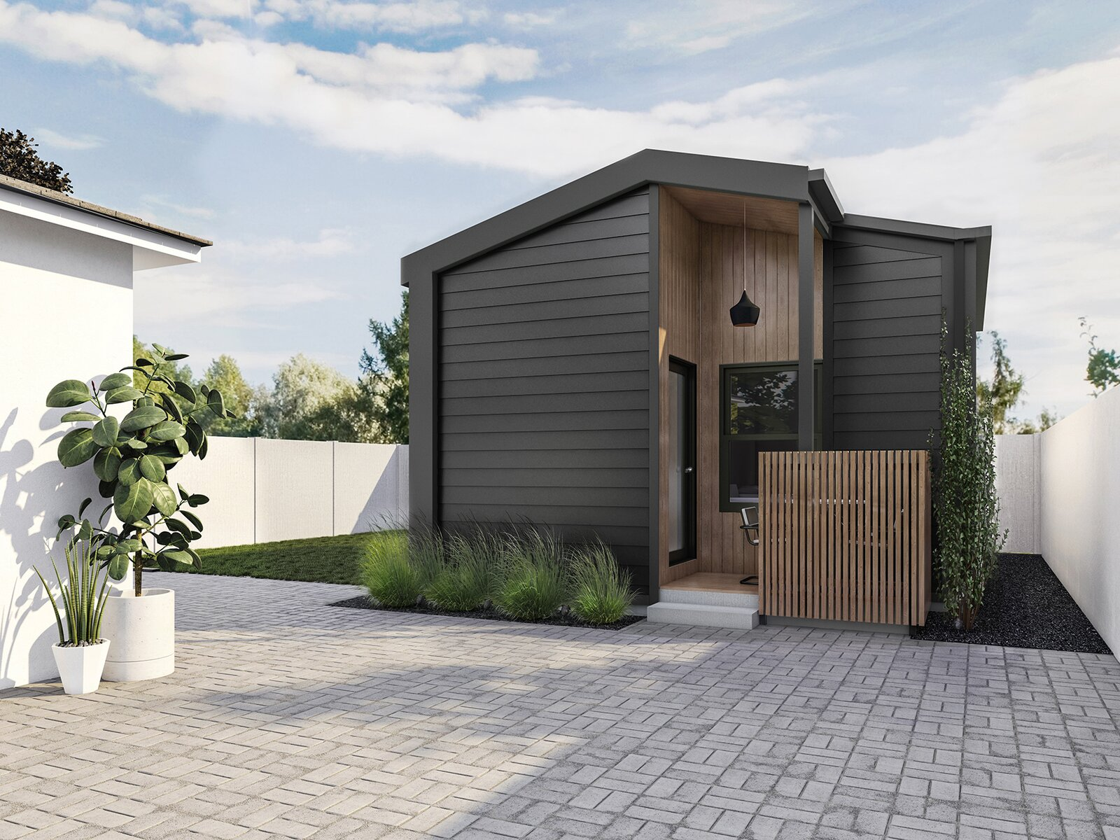Exterior, Wood Siding Material, Saltbox RoofLine, and Tiny Home Building Type United Dwelling's free ADUs feature a full kitchen, laundry, and outdoor space.  Photo 5 of 5 in These 5 Companies Want to Build a Tiny House in Your Backyard for Free