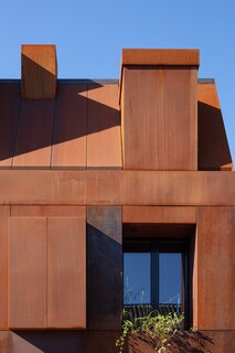 The Cor-Ten steel, now a bright orange-brown tone, will patina over time, lending a dynamic quality to the artful home.
