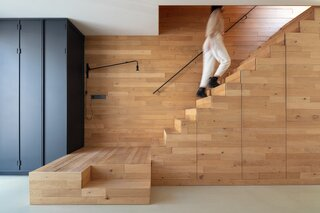 A sizable oak staircase, with a large landing and storage beneath it, leads to each level of the home.