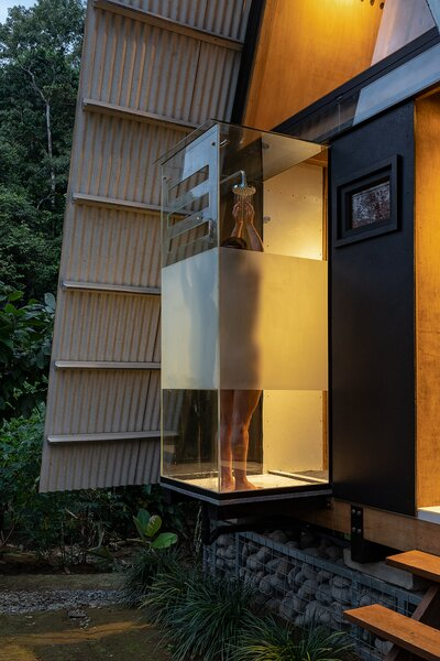 The cantilevered glass shower on the front facade features opaque banding that creates privacy.