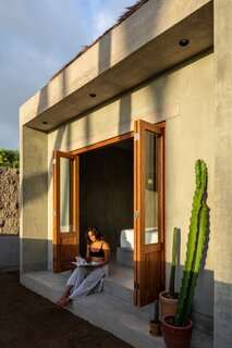 The indoor/outdoor quality of the modest residence was inspired by the cinematic quality of the natural surroundings.