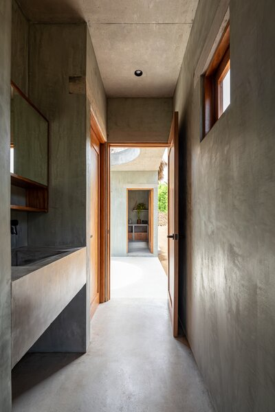 The clients must pass through the courtyard, experiencing the outdoors, as they move between the private and public spaces.