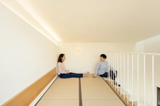 The loft-style sleeping area is finished with tatami flooring.