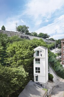 Architect Minwook Choi's 710-square-foot Seroro House rises from a tiny urban lot in Seoul that had long been neglected because of its challenging size.