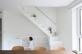 The narrow, steel and-wood staircase maximizes space for the rooms.