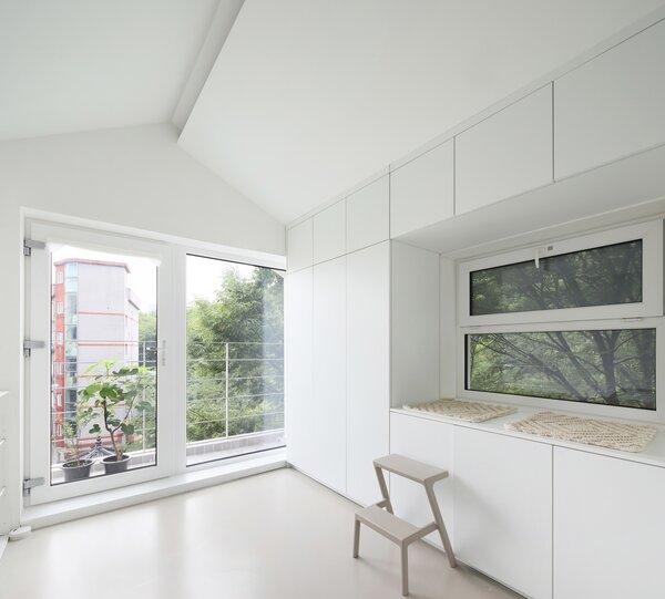 A laundry room, bathroom, and closet occupy the topmost floor.