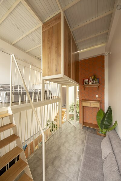 The child's bedroom loft is situated on a split level and overlooks the living area.
