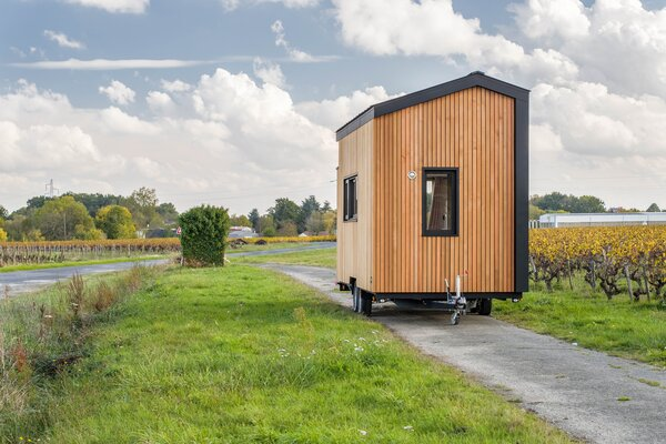 The power for the tiny home–on–wheels comes from a standard RV-style hookup.