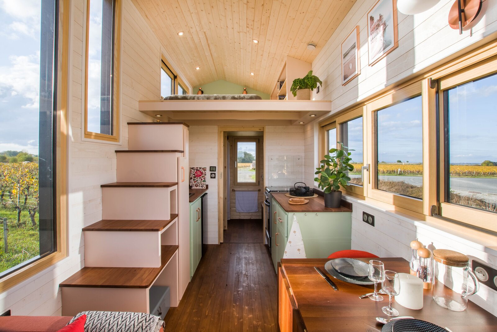 Ala Köl by Baluchon interior with dining space and stairs to sleeping loft