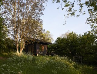 With its emphasis on the outdoors, the petite shelter in Normandy offers room to roam.