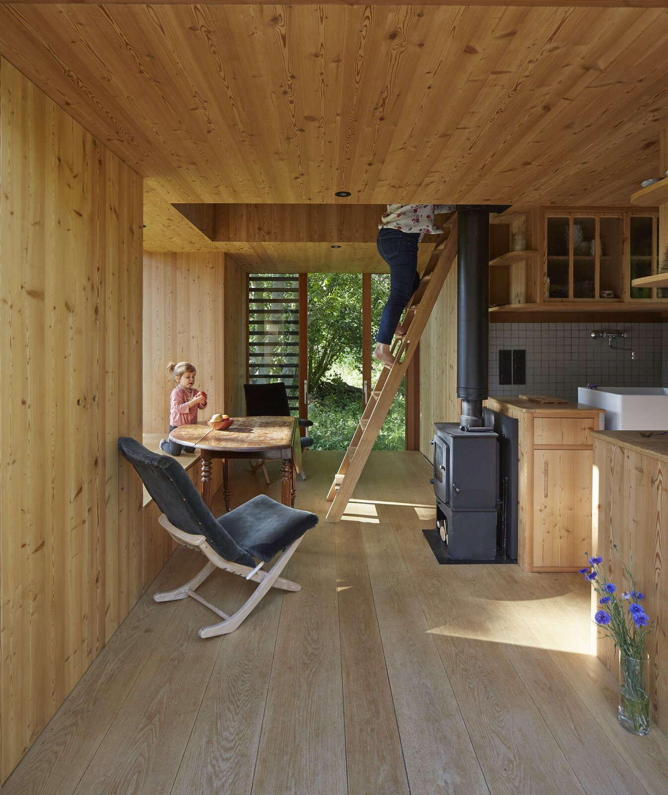 La Petite Maison by arba living areas with ladder leading to the lofts