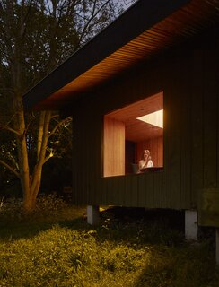 At night, the large window in the dining area creates a lantern-like effect for the cabin.