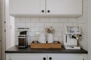 The kitchen coffee bar was a must-have for Joel. The bright white subway tile backsplash and the white cabinetry give the skoolie a fresh, open feeling.