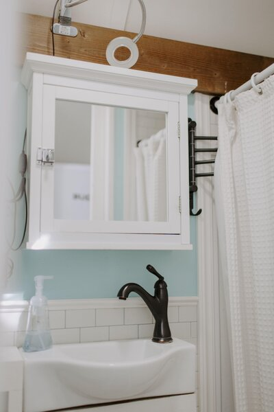 White subway tile and pale-blue paint enliven the bathroom, which the Binkerds expanded to make room for a claw-foot tub.