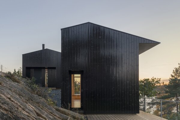 The 750-square-foot cabin that architect Jon Danielsen Aarhus designed in Son, Norway, is situated on a sloping hillside of solid rock that overlooks the sea.