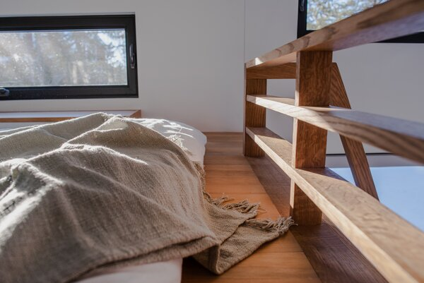 """The white oak loft railing allows for open sight lines and creates a more spacious feel for the loft bedroom,"" Kevin says."