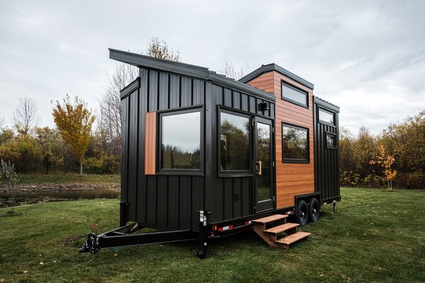 "Heather and Kevin Fritz's first project as Fritz Tiny Homes was a 268-square-foot dwelling sided with standing-seam metal and wood-textured aluminum. ""Metal siding assures a maintenance-free exterior regardless of exposure,"" says Kevin."