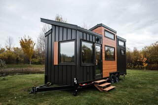"""Heather and Kevin Fritz's first project as Fritz Tiny Homes was a 268-square-foot dwelling sided with standing-seam metal and wood-textured aluminum. """"Metal siding assures a maintenance-free exterior regardless of exposure,"""" says Kevin."""