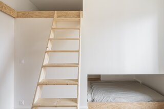 Escobar designed two sleeping alcoves in the sons' bedrooms—one is above the bathroom, which is adjacent to the boys' bedroom, and the other is beneath the daughter's bedroom, an elevated space that's