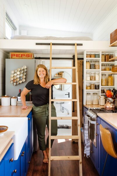 Sophia Jungbauer stands in the kitchen of the 324-square-foot home she built with her husband, Henry, in Duluth, Minnesota.