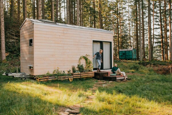 Datscha, the 194-square-foot cabin that Anna and Jakob Busch built with the help of family and friends, is clad with spruce siding and capped with a standing-seam metal roof.