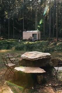 """The tiny home is parked in a forest, where there's an old stone quarry,"" Anna says. ""The land belongs to our friend Andy, who suggested we build outdoor tables with some of the boulders."""
