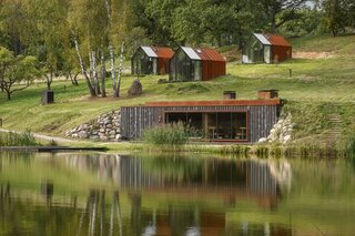 The cabins and sauna that architect Zane Tetere-Sulce designed for the Ziedlejas Wellness Resort are clad with Cor-Ten steel and glass.