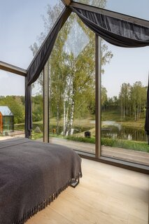 The cabins feature foldaway beds and glazed walls that create the impression of sleeping outdoors.