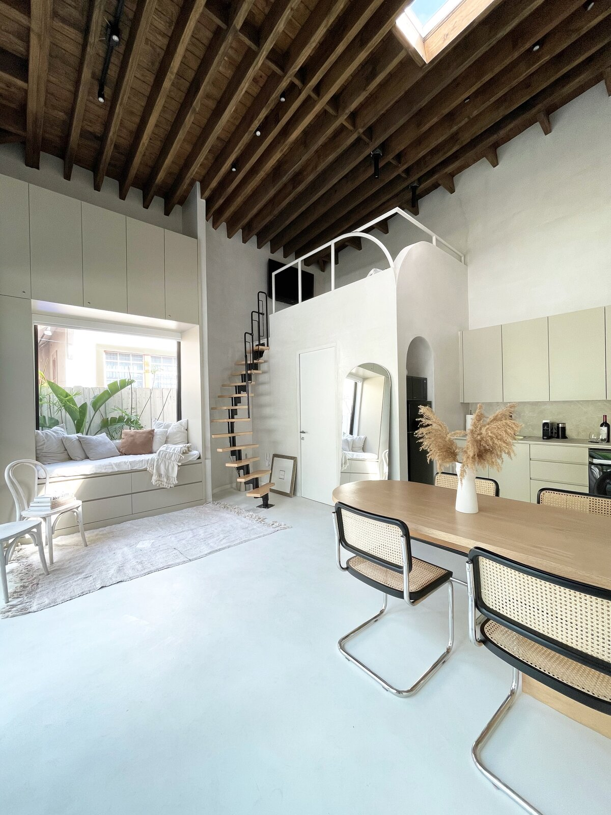 Large windows, doors, and a skylight flood the guesthouse and studio with plenty of sunlight.