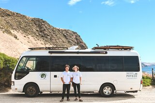 An Australian Couple Turn a Bus Into a Traveling Tiny Home and Physical Therapy Practice