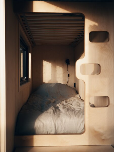 Sunlight pours in through the windows and highlights the wood grain that wraps the interior, lending warmth and texture.