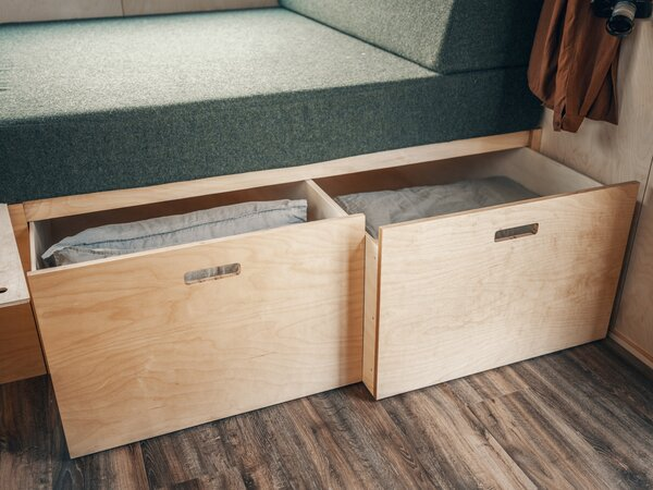 Two sizable storage drawers pull out from beneath the built-in daybed in the living area.