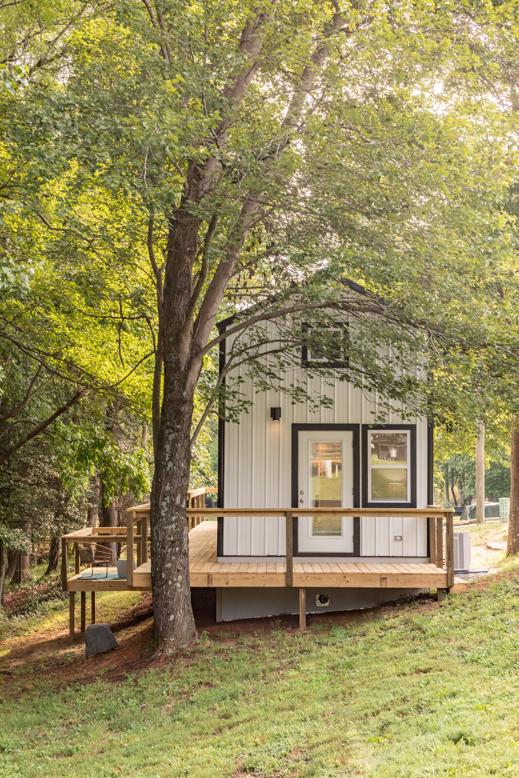 Exterior, Tiny Home Building Type, Metal Siding Material, Metal Roof Material, and Gable RoofLine Eclipse founder Justin Draplin explains his scheme for the 399-square-foot dwellings that include sustainable features such as solar power, in addition to spacious and flexible interiors.  Photo 1 of 13 in This South Carolina Company Offers Tiny Cottages With Off-Grid Capabilities
