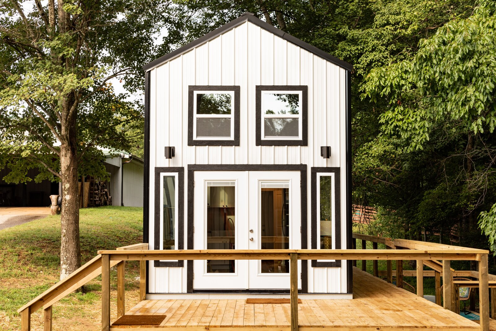 Exterior, Tiny Home Building Type, Metal Siding Material, Gable RoofLine, and Metal Roof Material The 399-square-foot homes in Greenville, South Carolina, created by Justin Draplin of Eclipse Cottages are clad in white-painted steel siding.  Photo 2 of 13 in This South Carolina Company Offers Tiny Cottages With Off-Grid Capabilities