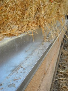 Rice straw bale, sourced from a local farmer, were placed on top of the Watershed Block walls, sequestering carbon while insulating the home.