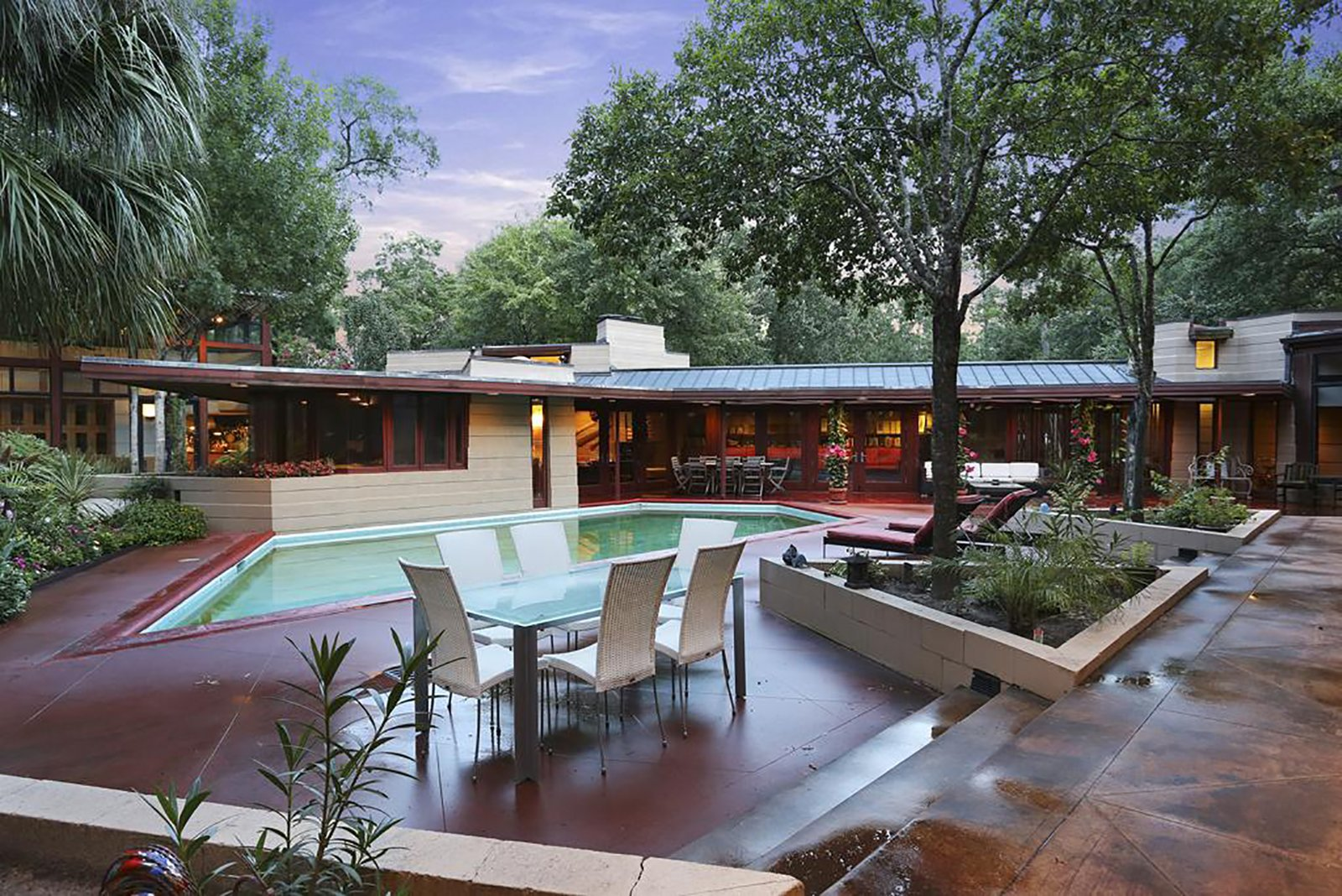 Distinguished as the only home in Houston designed by Frank Lloyd Wright, this masterpiece is an art collector's paradise. Ideal for both casual living and grand entertaining, this private residence features multiple art galleries, high ceilings, geothermal temperature system and the original built-in furniture.  Photo 4 of 11 in Unforgettable Midcentury Homes by Modern Masters