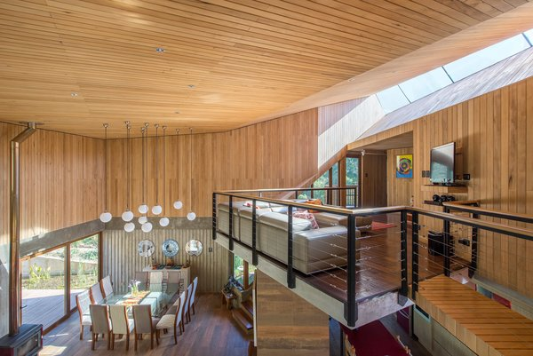 """A long, slender skylight illuminates the top-floor lounge area. """"The home's location on the eastern slope of the creek ensures prolonged sunlight throughout the year, while also being optimally exposed to the prevailing rising air currents in the valley,"""" states the firm."""