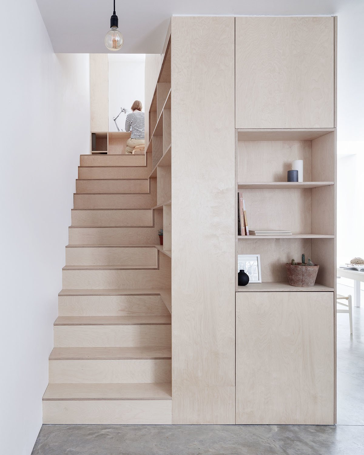 Storage Room, Cabinet Storage Type, and Shelves Storage Type Photo caption: Clean lines in plywood and ample hidden storage give this home a sleek contemporary look.  Photo 3 of 10 in 10 Clever Ways to Sneak Storage Into Your Renovation