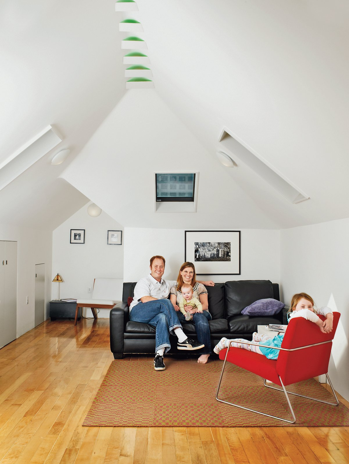 The extra 500 sq ft of space from an attic remodel was the major perk of this home renovation.  Photo 9 of 11 in 10 Bright and Airy Modern Attic Renovations