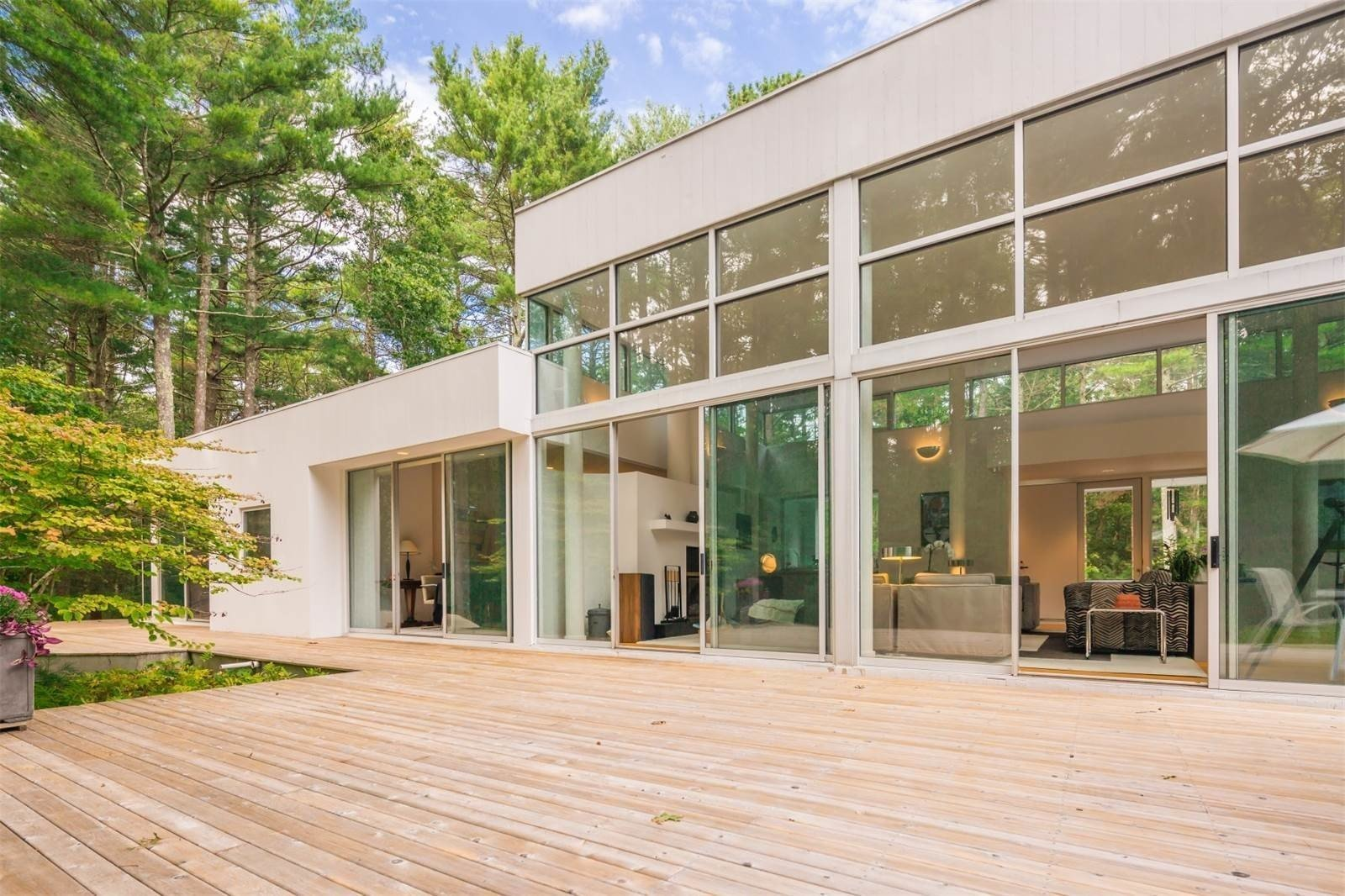 16-foot-high ceilings and dramatic expanses of glass allow light to stream into the open floor plan year-round.  Photo 8 of 11 in Spotted: 10 Modern Homes in the Hamptons