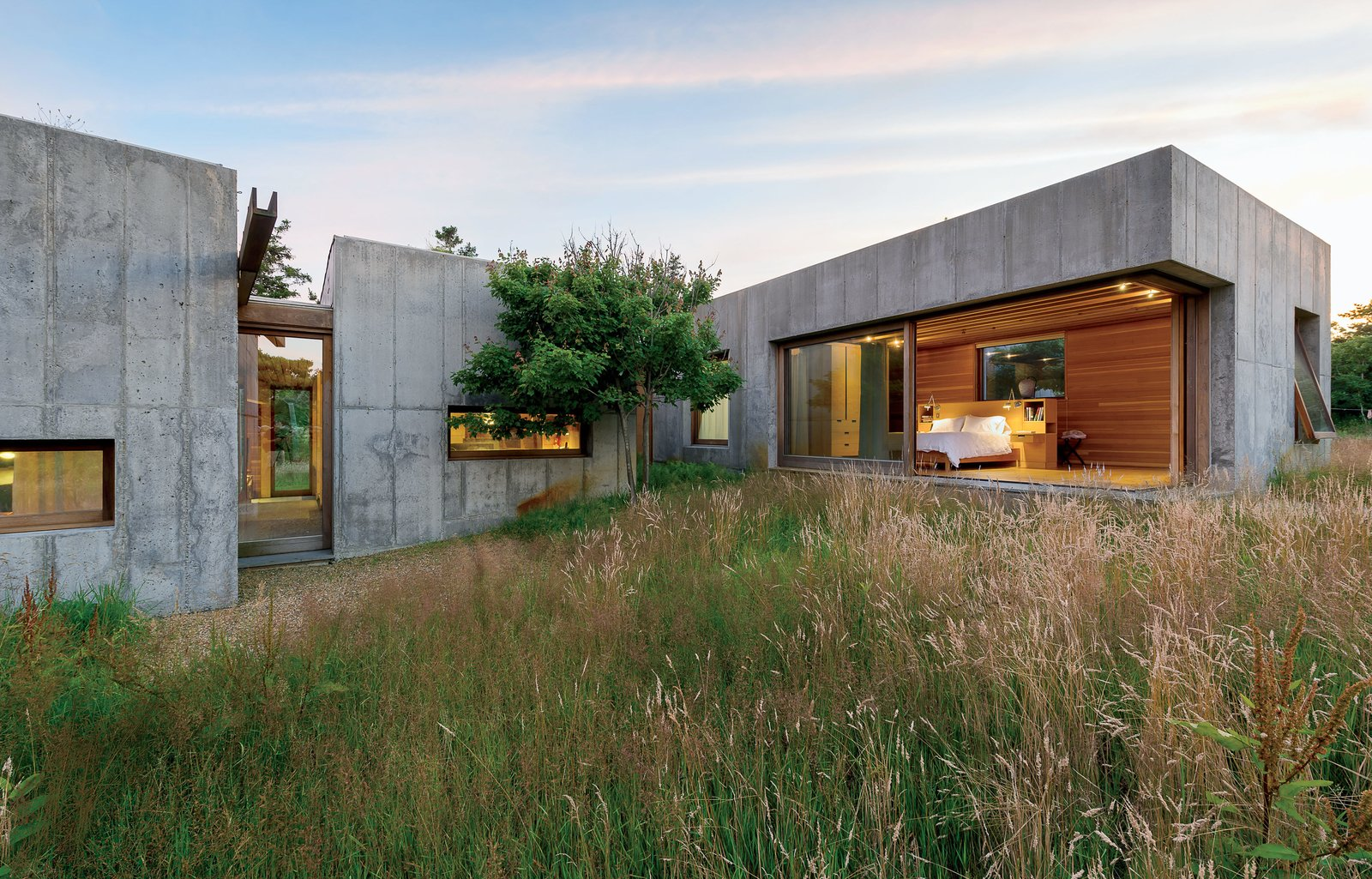 Six modular, concrete boxes comprise a five-bedroom home on Martha's Vineyard, in Chilmark, Massachusetts. Designed with the sloping seaside site in mind, it was built to guard against potential erosion.  Photo 9 of 11 in Material Spotlight: 10 Killer Concrete Homes
